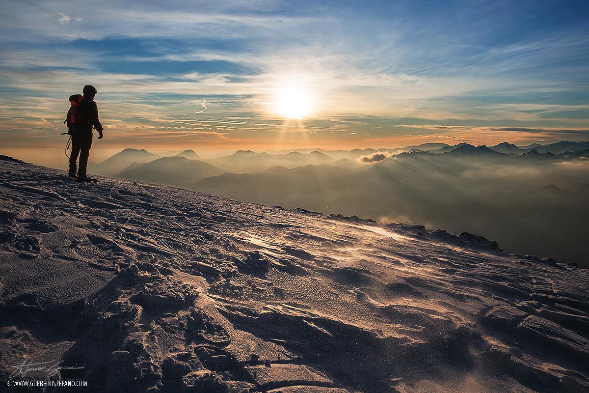 Tramonto Altissimo con neve al vento Guerrini Stefano